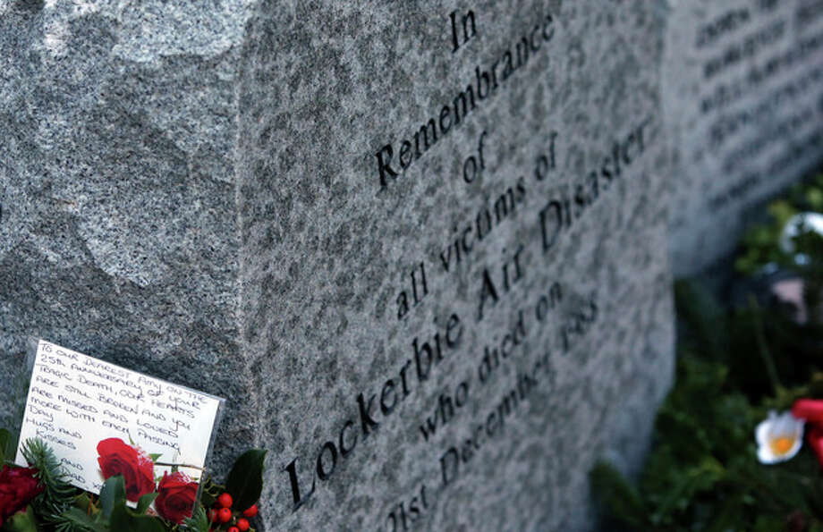 A handwritten card is seen on a wreath laid by the main memorial stone, in memory of a victim of the Pan Am flight 103 bombing, in the garden of remembrance at Dryfesdale Cemetery, near Lockerbie, Scotland. Saturday Dec. 21, 2013. Pan Am flight 103 was blown apart above the Scottish border town of Lockerbie on Dec. 21, 1988. All 269 passengers and crew on the flight and 11 people on the ground were killed in the bombing. (AP Photo/Scott Heppell). / AP