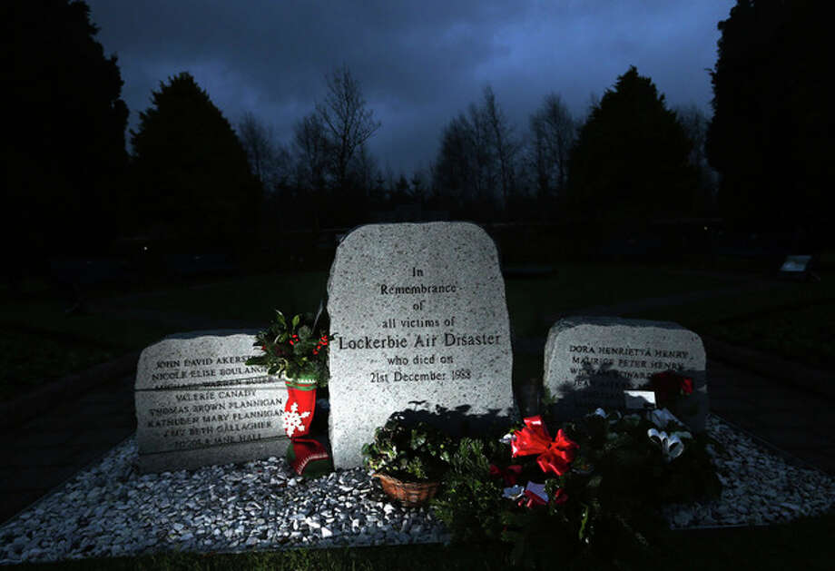 Floral tributes are seen near the main memorial stone in memory of the victims of Pan Am flight 103 bombing in the garden of remembrance at Dryfesdale Cemetery, near Lockerbie, Scotland, Saturday, Dec. 21, 2013. Pan Am flight 103 was blown apart above the Scottish border town of Lockerbie on Dec. 21, 1988. All 269 passengers and crew on the flight and 11 people on the ground were killed in the bombing. (AP Photo/Scott Heppell). / AP