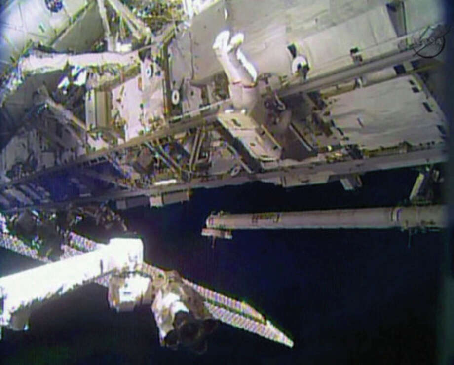 AP photo / NASAIn this image made from video provided by NASA, astronaut Rick Mastracchio performs a space walk outside the International Space Station on Saturday. / NASA
