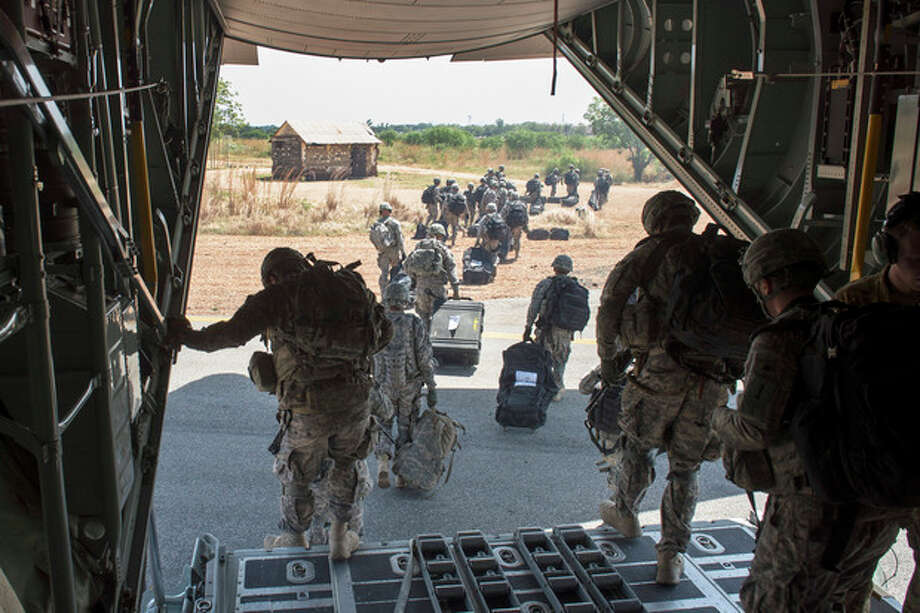 In this photo taken Wednesday, Dec. 18, 2013 and released by the U.S. Air Force, soldiers of the East Africa Response Force (EARF), a Djibouti-based joint team assigned to Combined Joint Task Force-Horn of Africa, depart from a U.S. Air Force C-130 Hercules in Juba, South Sudan to support with an ordered departure of personnel from the city. Gunfire hit three U.S. military CV-22 Osprey aircraft Saturday, Dec. 21, 2013 trying to evacuate American citizens in Bor, the capital of the remote region of Jonglei state in South Sudan, that on Saturday became a battle ground between South Sudan's military and renegade troops, officials said, with four U.S. service members wounded in the attack. (AP Photo/U.S. Air Force, Tech. Sgt. Micah Theurich) / U.S. Air Force
