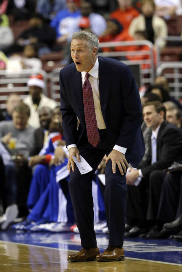Philadelphia 76ers head coach Brett Brown reacts to a call during the first half of an NBA basketball game against the Brooklyn Nets, Friday, Dec. 20, 2013, in Philadelphia. (AP Photo/Matt Slocum)