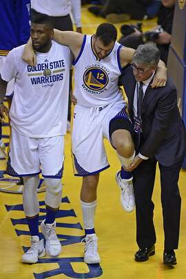 Golden State Warriors' Andrew Bogut (12) is assisted off the court after sustaining an injury during the third quarter on Monday, June 13, 2016, at Oracle Arena in Oakland, Calif. (Jose Carlos Fajardo/Bay Area News Group/TNS)