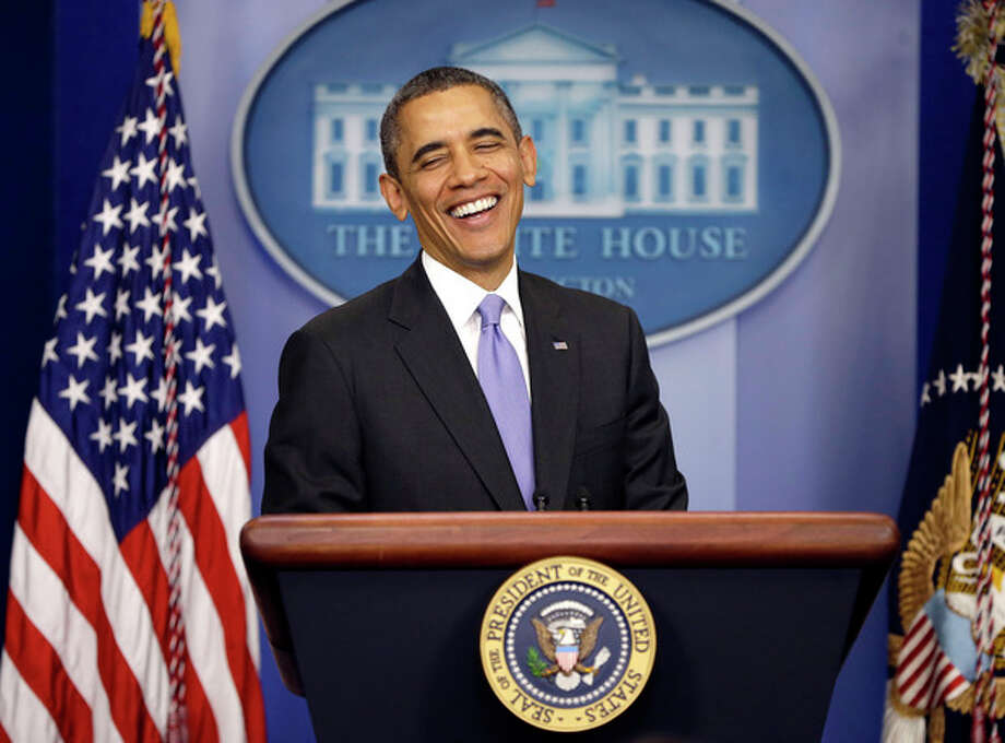 President Barack Obama smiles as he prepares to answer a question during an end-of-the year news conference in the Brady Press Briefing Room at the White House in Washington, Friday, Dec. 20, 2013. Obama will depart later for his home state of Hawaii for his annual Christmas vacation trip. It's the first time in his presidency that his departure plans have not been delayed by legislative action in Washington. (AP Photo/Pablo Martinez Monsivais) / AP