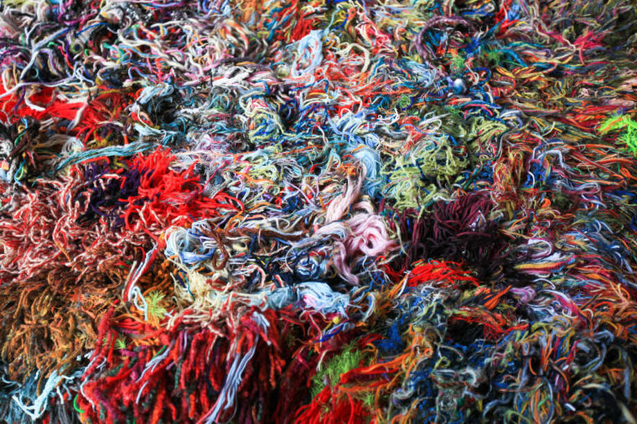 "Hour photo / Chris Palermo. A pile of yark on display at the ""Holiday Social Fiber Fabric Arts & Makers"" pop up art show presented by Pop City Saturday in Norwalk."