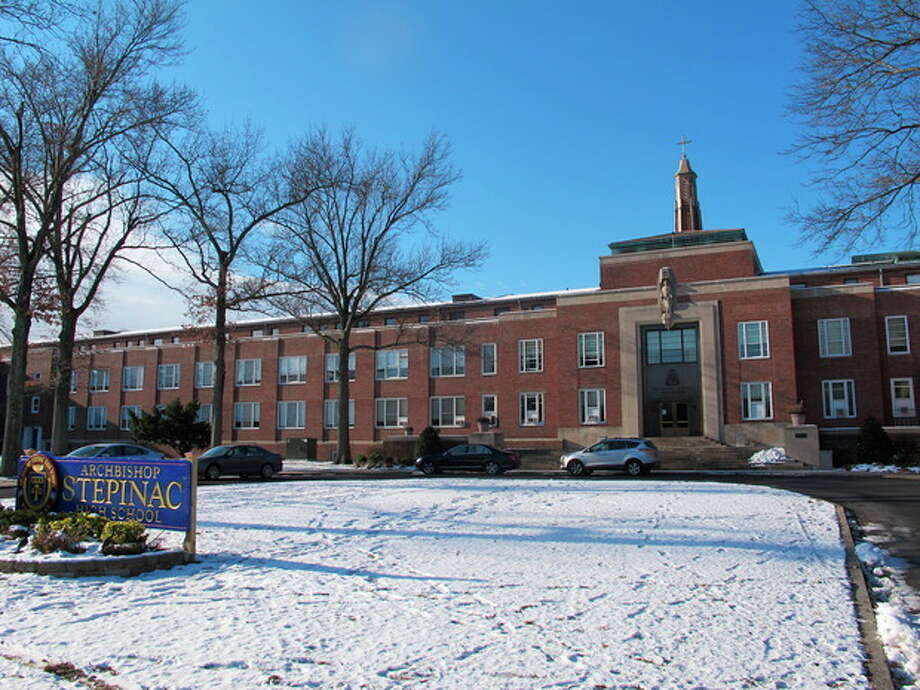 This Dec. 13, 2013, photo shows Archbishop Stepinac High School in White Plains, N.Y. The Catholic boys' school is joining a national trend, and has dumped all its heavy, expensive printed textbooks and put the material online. (AP Photo/Jim Fitzgerald) / AP
