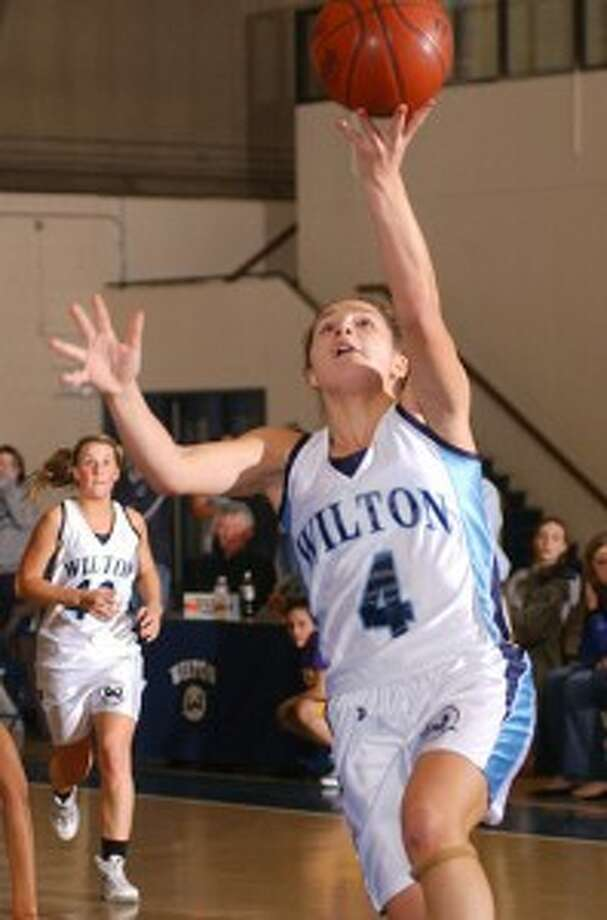 Wilton girls get first hoop win