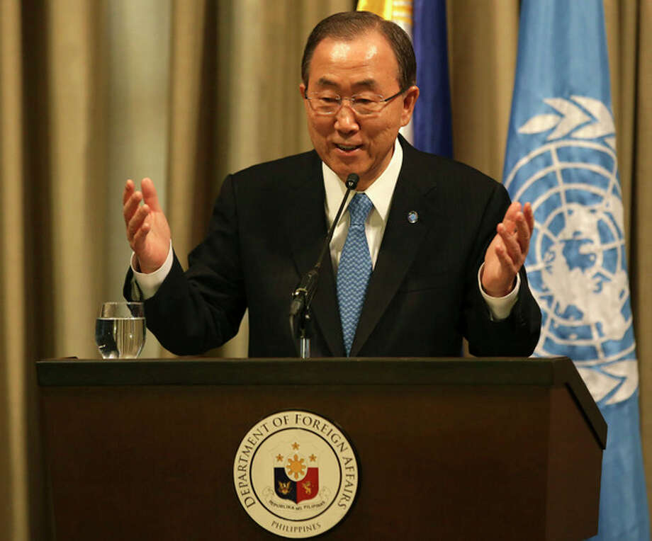 "United Nations Secretary General Ban Ki-moon gestures as he answers questions from reporters in Makati, south of Manila, Philippines on Sunday, Dec. 22, 2013. Moon is urging the international community to ramp up aid for the Philippines' typhoon reconstruction, saying ""we must not allow this to be another forgotten crisis."" (AP Photo/Aaron Favila) / AP"