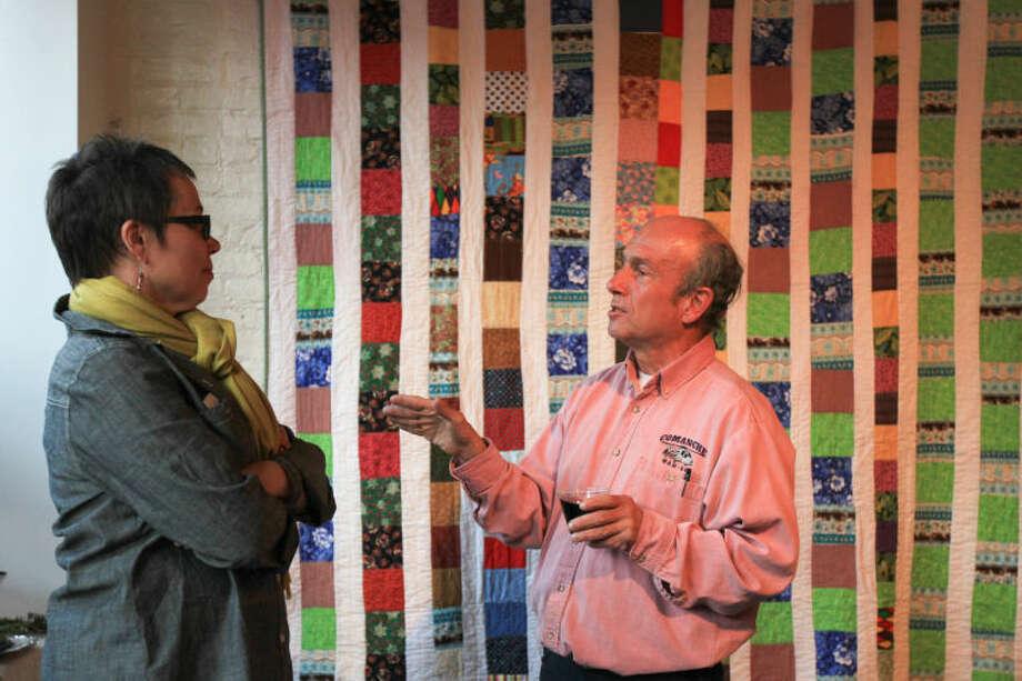 "Hour photo / Chris Palermo. Frank Polito has a talk with Mary Shiffer at the ""Holiday Social Fiber Fabric Arts & Makers"" pop up art show presented by Pop City Saturday in Norwalk."