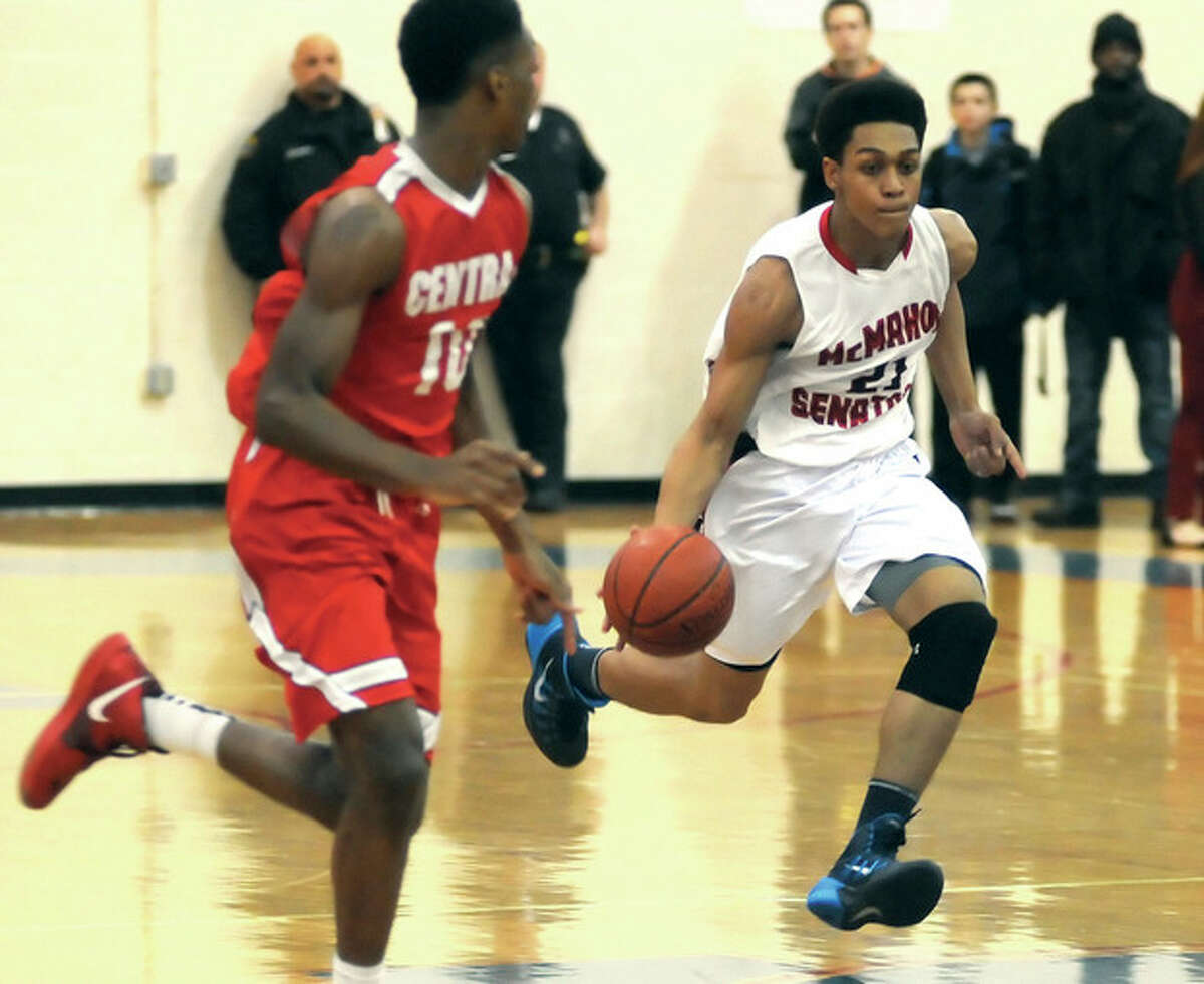 Hour photo/John Nash Brien McMahon's Timothy Hinton Jr. pushes the ball up the court during Friday night's game against Bridgeport Central. A late rally by the Senators fell short, and Central won, 62-57.