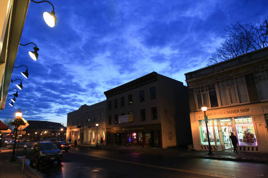 Hour photo / Chris Palermo. Twighlight sets in over South Main St. Saturday evening.