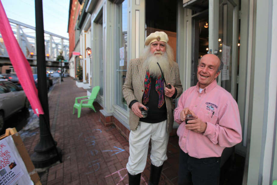 """Hour photo / Chris Palermo. Rich Glica and Frank Polito has a dink outside the """"Holiday Social Fiber Fabric Arts &Makers"""" pop up art show presented by Pop City Saturday in Norwalk."""