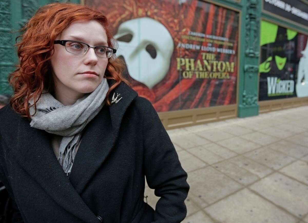 AP Photo/M. Spencer Green In this Dec. 3, file photo, actor Adrienne Matzen poses in Chicago's theater district. Matzen, 29, who has been mostly uninsured since she turned 21, is now looking for a low monthly premium insurance plan on the federal website.