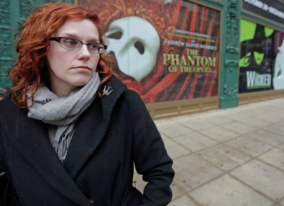 AP Photo/M. Spencer GreenIn this Dec. 3, file photo, actor Adrienne Matzen poses in Chicago's theater district. Matzen, 29, who has been mostly uninsured since she turned 21, is now looking for a low monthly premium insurance plan on the federal website. / AP