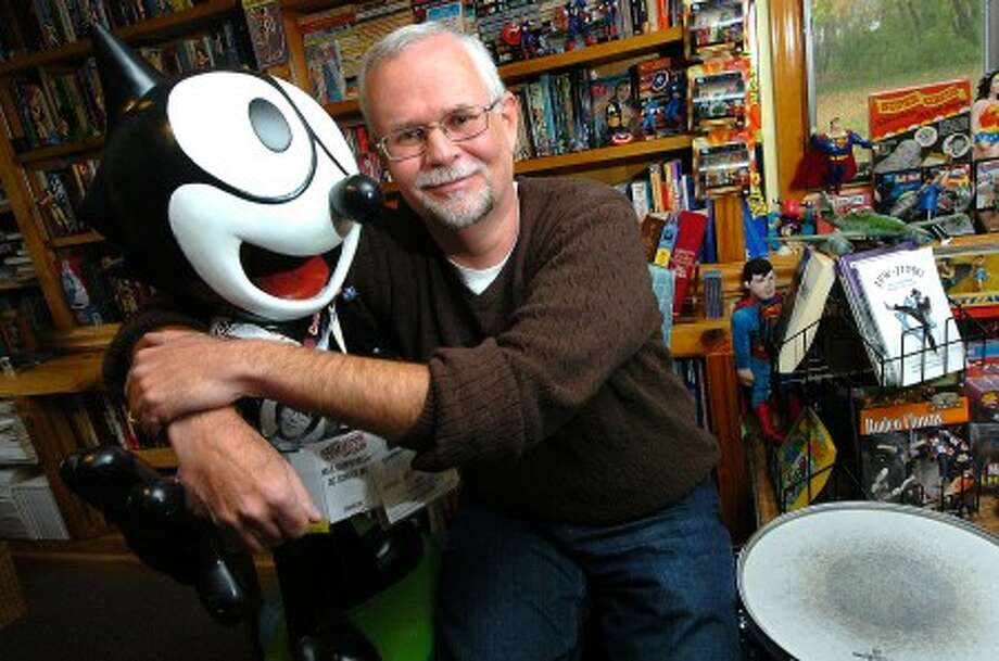Photo/Alex von Kleydorff. Paul Kupperberg with Felix the Cat, a gift from a friend, in his Stamford studio.
