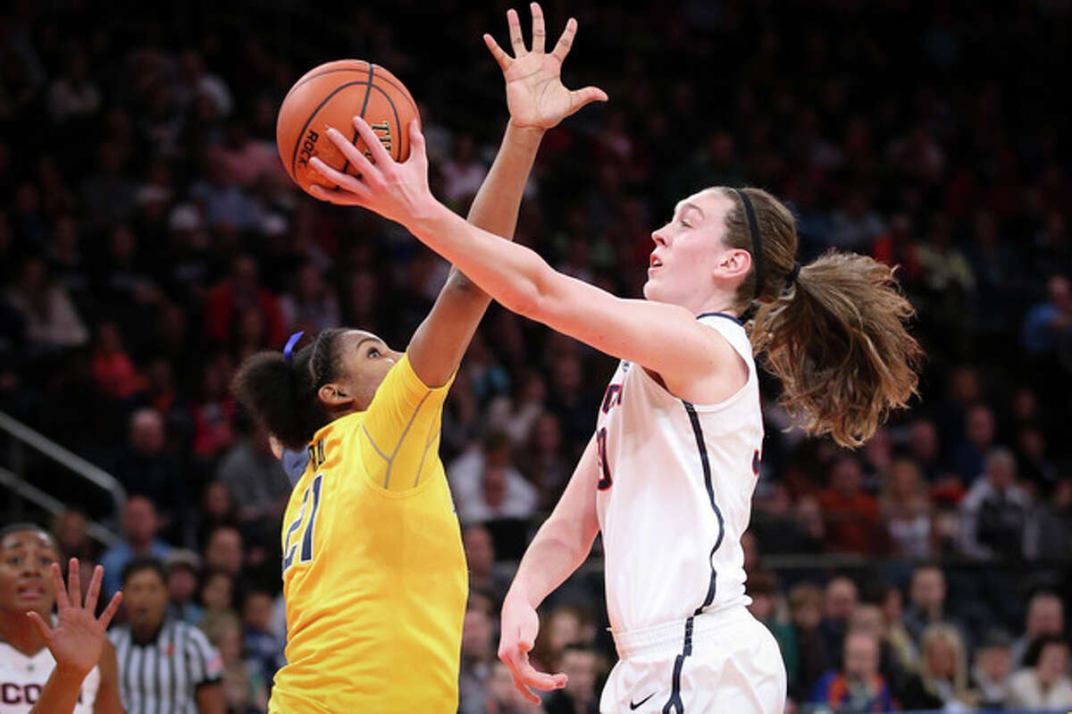 Connecticut forward Breanna Stewart, right, shoots against California forward Reshanda Gray (21) during the first half of an NCAA college basketball game as part of the Maggie Dixon Basketball Classic at Madison Square Garden, Sunday, Dec. 22, 2013, in New York. (AP Photo/John Minchillo)