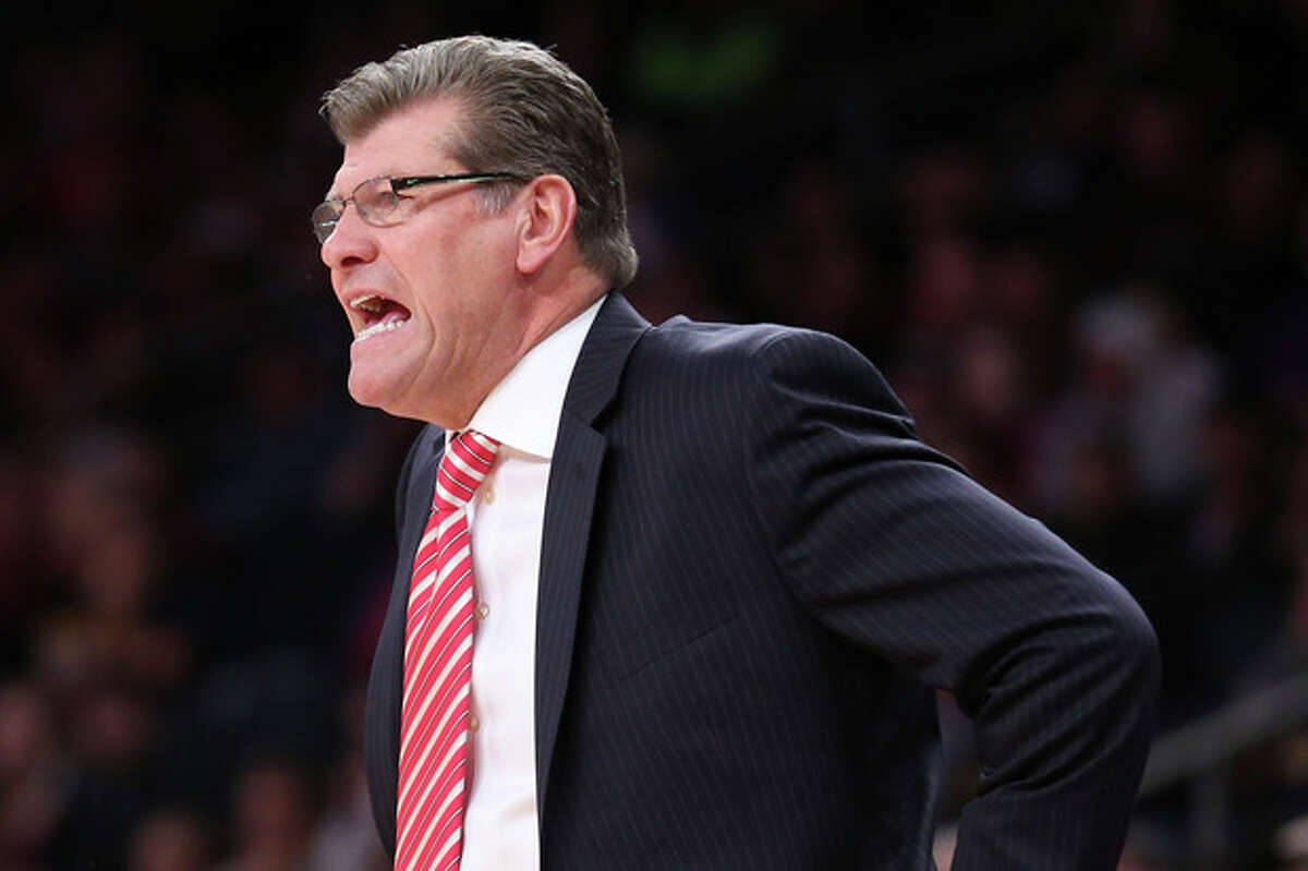 Connecticut head coach Geno Auriemma directs his players from the bench during the first half of their NCAA college basketball game as part of the Maggie Dixon Basketball Classic at Madison Square Garden, Sunday, Dec. 22, 2013, in New York. (AP Photo/John Minchillo)