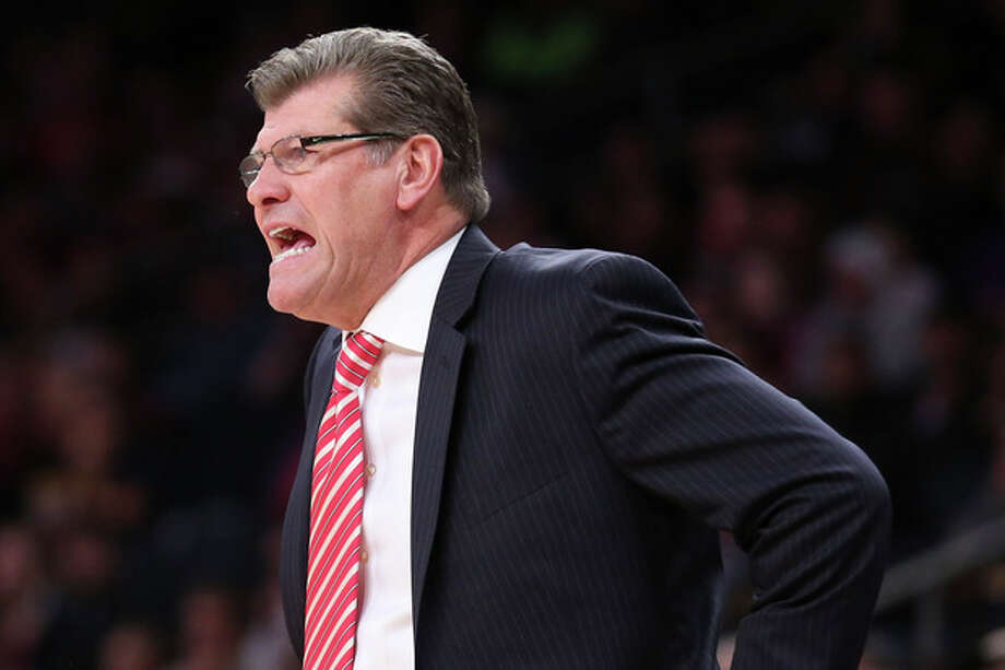 Connecticut head coach Geno Auriemma directs his players from the bench during the first half of their NCAA college basketball game as part of the Maggie Dixon Basketball Classic at Madison Square Garden, Sunday, Dec. 22, 2013, in New York. (AP Photo/John Minchillo) / FR170537 AP
