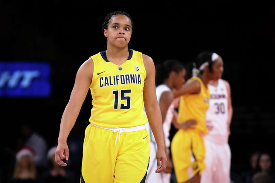California guard Brittany Boyd (15) reacts during the first half of an NCAA college basketball game against Connecticut as part of the Maggie Dixon Basketball Classic at Madison Square Garden, Sunday, Dec. 22, 2013, in New York. (AP Photo/John Minchillo) / FR170537 AP
