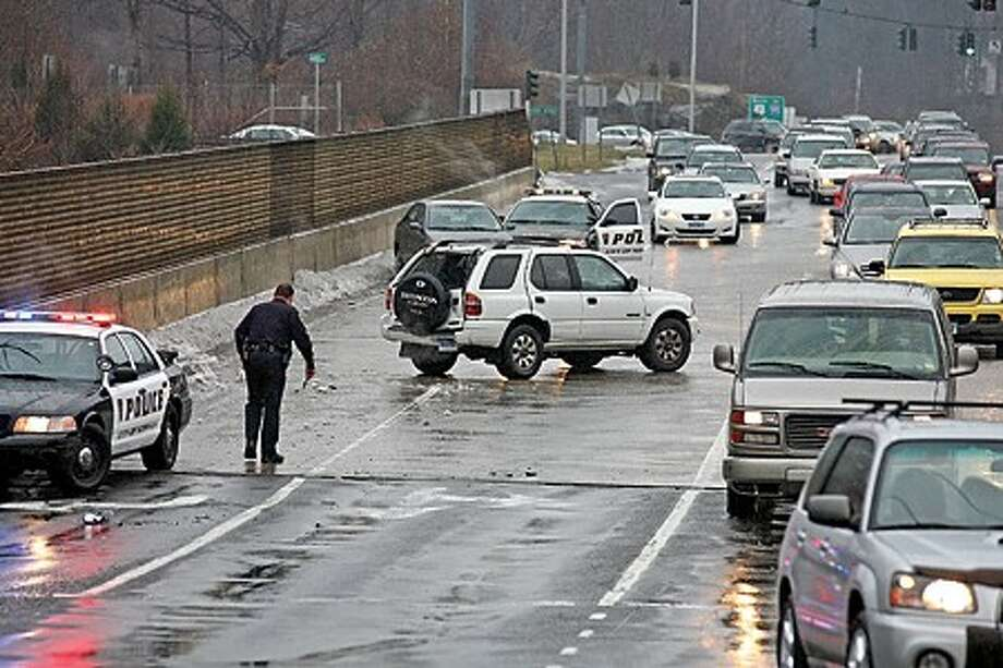 Icy weather conditions led to an accident off of the Route 7 Connector in Norwalk Sunday afternoon. Hour Photo / Danielle Robinson