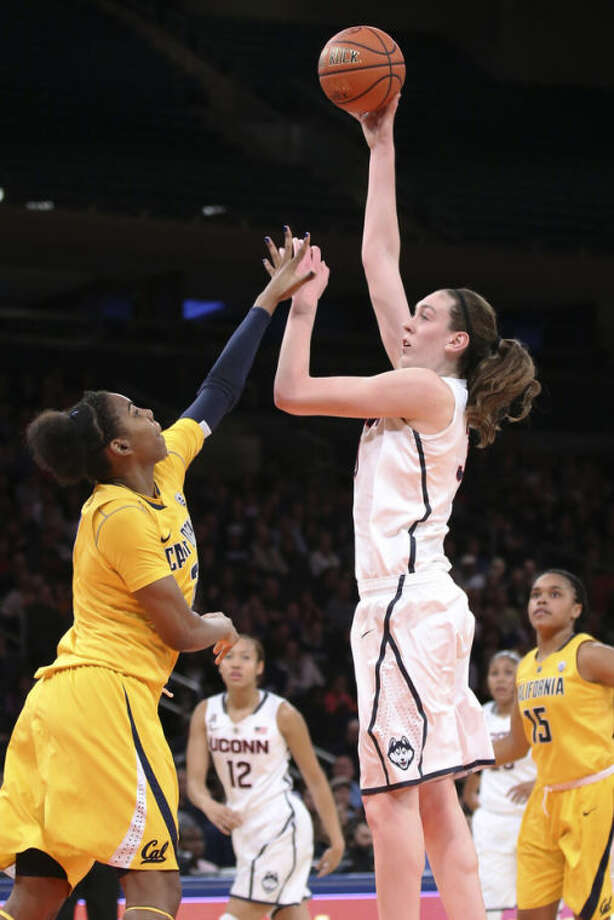 Connecticut forward Breanna Stewart (30) shoots over California forward Reshanda Gray (21) during the first half of an NCAA college basketball game as part of the Maggie Dixon Basketball Classic at Madison Square Garden, Sunday, Dec. 22, 2013, in New York. (AP Photo/John Minchillo)