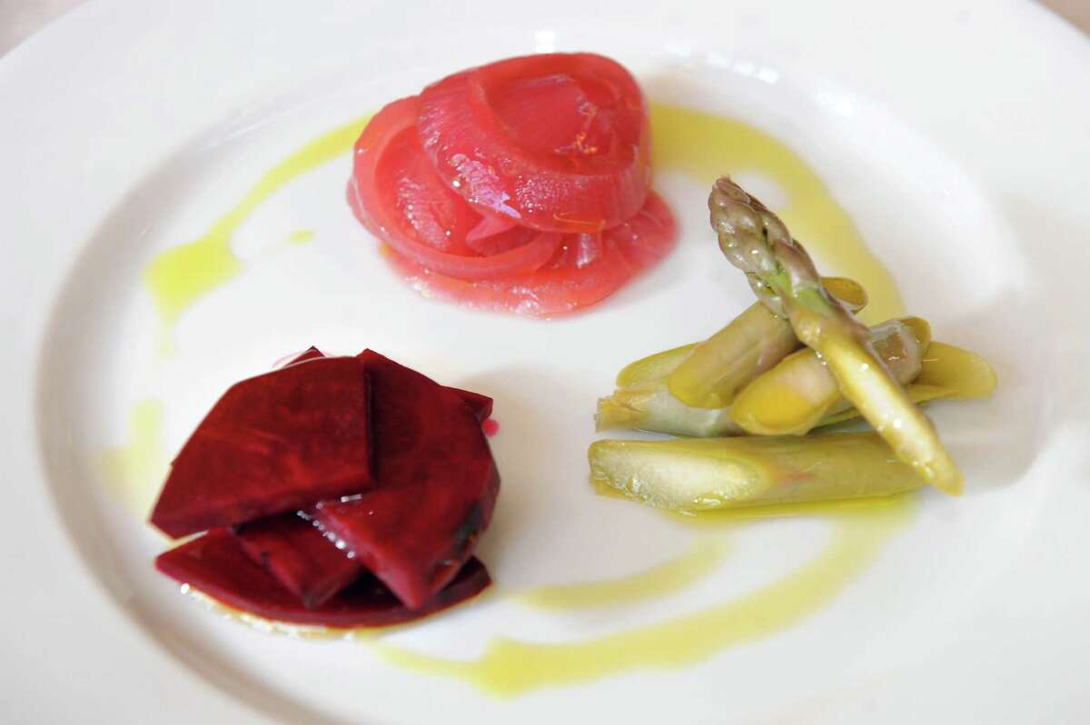 Pickle Plate has house-crafted pickled beet, asparagus and red onion with olive oil at Sweet Beet Bistro in Greenwich. (Cindy Schultz / Times Union)