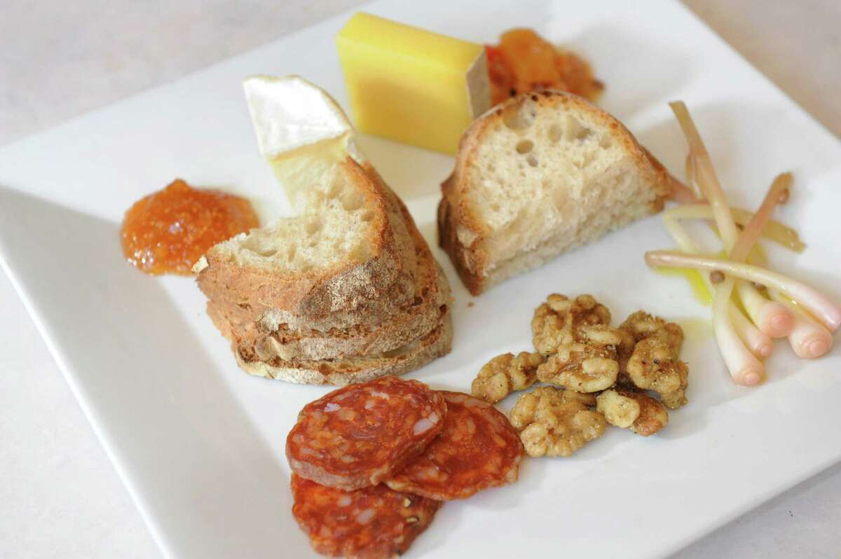 Hors d'oeuvre Plate features cured organic meat, spiced nuts, pickled ramps, mango chutney, fig jam, handmade cheese and fresh bread at Sweet Beet Bistro in Greenwich. (Cindy Schultz / Times Union)
