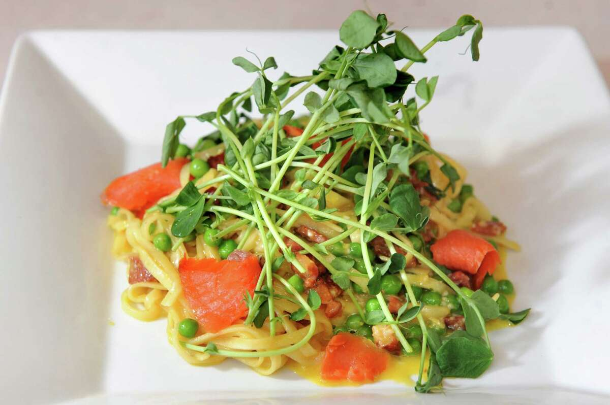 Creamy Salmon Carbonara has smoked salmon, fresh linguini, white wine, garlic, crisp bacon, pastured egg, spring peas, shaved parmesan and tender pea shoots at Sweet Beet Bistro in Greenwich. (Cindy Schultz / Times Union)