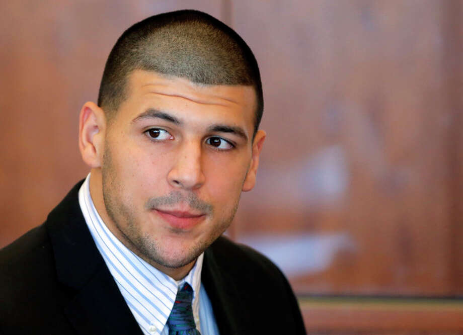 FILE - In this Oct. 9, 2013 file photo, former New England Patriots NFL football player Aaron Hernandez attends a pretrial court hearing in Fall River, Mass. Hernandez has pleaded not guilty in the killing of 27-year-old Odin Lloyd, a semi-professional football player from Boston who was dating the sister of Hernandez's girlfriend. On Monday, Dec. 16, 2013, Lloyd's family filed a wrongful death suit against Hernandez in court in New Bedford, Mass. (AP Photo/Brian Snyder, Pool, File) / Pool Reuters