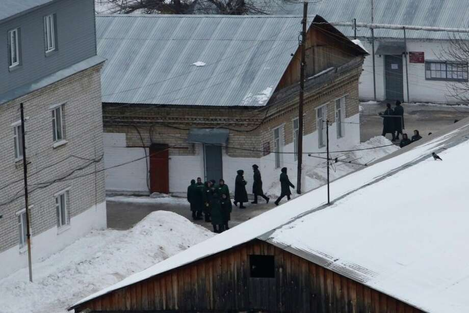 Prisoners walk inside the prison colony where jailed feminist punk band Pussy Riot member Maria Alekhina is held, outside Nizhny Novgorod, Russia, Friday, Dec. 20, 2013. The State Duma on Wednesday passed an amnesty bill which would release thousands of Russian prisoners including the jailed members of Pussy Riot. (AP Photo/Denis Tyrin) / AP