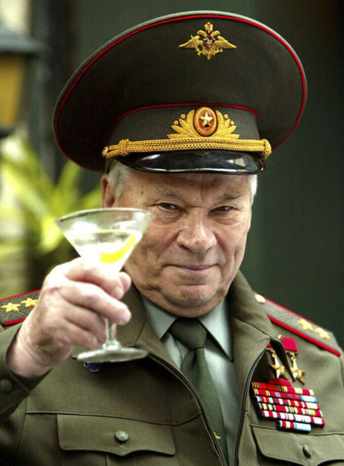 FILE - In this Monday Sept. 20, 2004 file photo, Russia's Lt. Gen. Mikhail Kalashnikov, famous for his AK-47 gun design, launches his Kalashnikov vodka drink in London. Mikhail Kalashnikov, whose work as a weapons designer for the Soviet Union is immortalized in the name of the world's most popular firearm, has died at the age of 94, Monday Dec. 23, 2013. (AP Photo/John D McHugh, File)