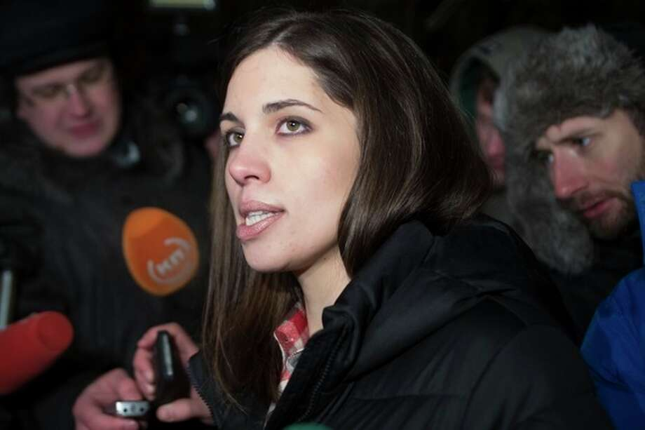 Nadezhda Tolokonnikova speaks to the media after leaving prison in Krasnoyarsk, Russia, Monday, Dec. 23, 2013. The third member of the Russian punk bank Pussy Riot has been released from custody following an amnesty law passed by parliament. Tolokonnikova left the prison colony in the eastern Siberian city Krasnoyarsk on Monday, hours after another band member, Maria Alekhina, was released in another region. (AP Photo/Tatyana Vishnevskaya) / AP