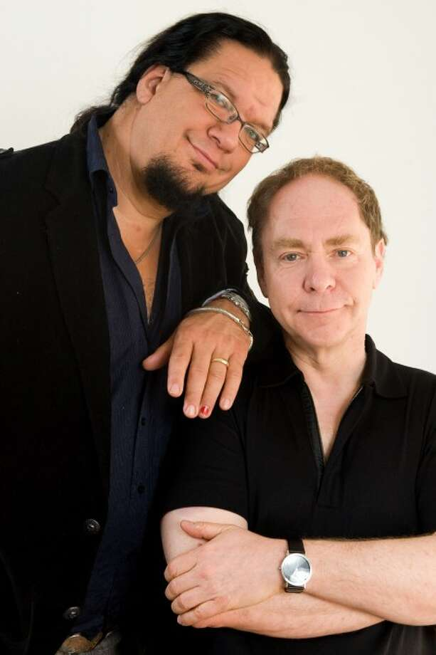 Magicians Penn Jillette, left, and Raymond Teller of Penn & Teller pose for a portrait in New York. (AP Photo/Charles Sykes, file)