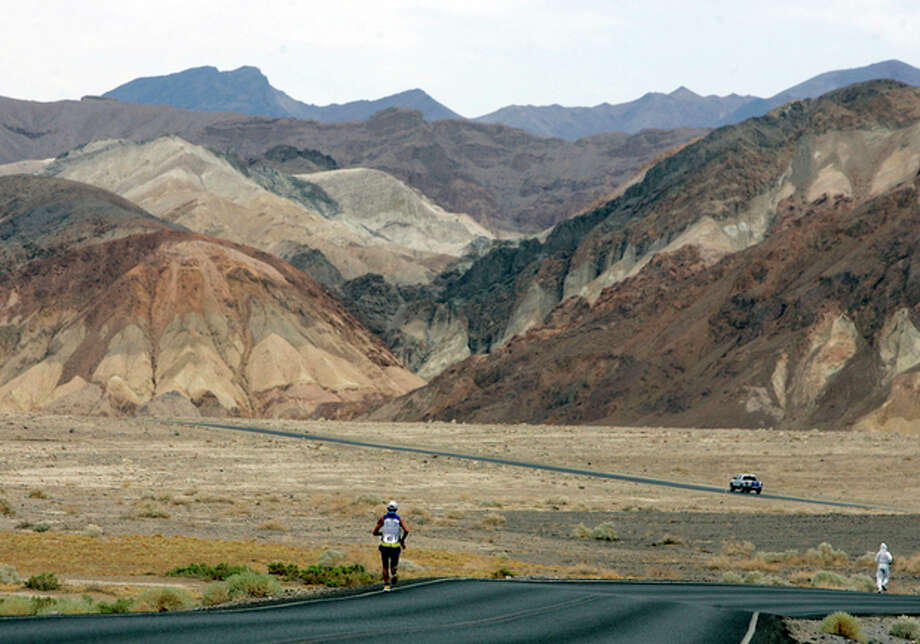 FILE - In this July 23, 2007, file photo, Valmir Nunes, of Brazil, runs in Kiehl's Badwater Ultramarathon in Death Valley, Calif. The race start line was at Badwater, Death Valley, which marks the lowest elevation in the Western Hemisphere at 280 feet below sea level. The race finished after 135 miles at the Mount Whitney Portals at 8,360 feet. Death Valley National Park is putting the brakes on ultramarathons and other extreme sports events that involve running and cycling until rangers can determine how safe it is to hold those competitions in a place that records the hottest temperatures on Earth. (AP Photo/Chris Carlson, File) / AP