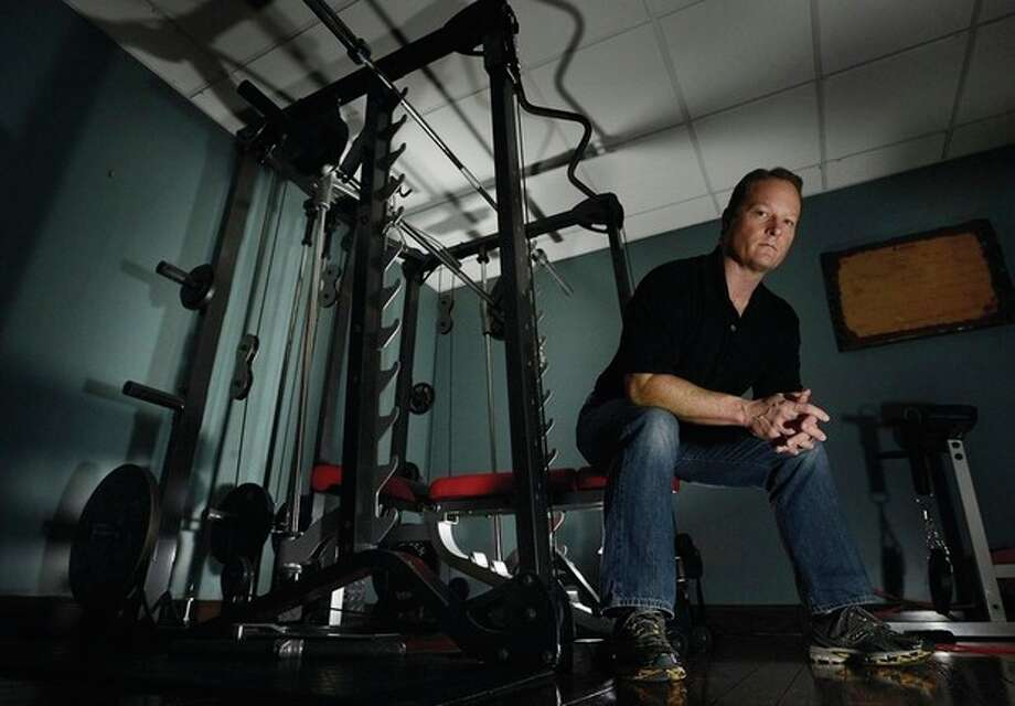 AP photo / Mark ZaleskiIn this Dec. 17 photo, Dr. Jason Cabler sits in the exercise room of his home in Hendersonville, Tenn. Cabler, 46, suffered a heart attack on Christmas Day in 2012 while lifting weights in the basement gym. Studies indicate that heart troubles, including fatal heart attacks, spike this time of year, especially on Christmas and New Year's. / FR170793 AP