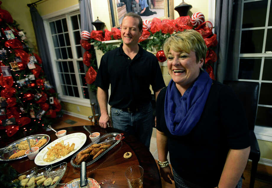 In this Dec. 17, 2013 photo, Dr. Jason Cabler and his wife, Angie, get ready for a holiday party at their home in Hendersonville, Tenn. Dr. Cabler, 46, suffered a heart attack on Christmas Day in 2012 while lifting weights in the exercise room in their home. Studies indicate heart troubles, including fatal heart attacks, spike this time of year, especially on Christmas and New Year's. (AP Photo/Mark Zaleski) / FR170793 AP