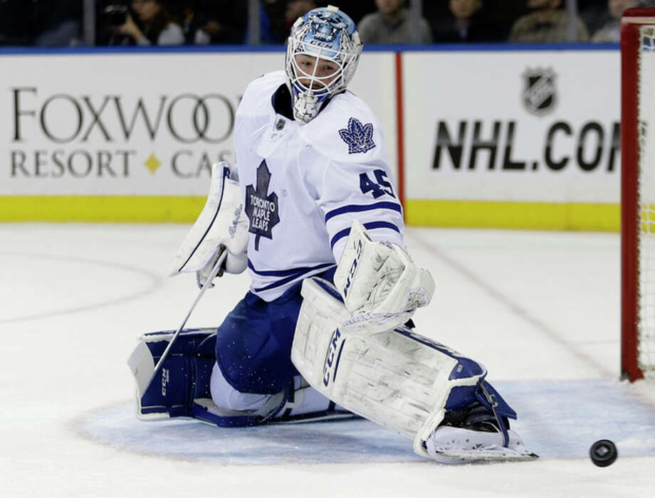 Toronto Maple Leafs goalie Jonathan Bernier (45) deflects a shot on the goal during the second period of an NHL hockey game against the New York Rangers, Monday, Dec. 23, 2013, in New York. (AP Photo/Frank Franklin II) / AP