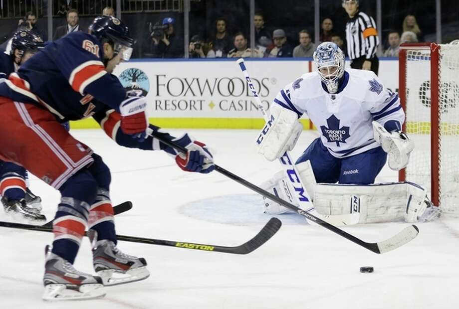 Toronto Maple Leafs goalie Jonathan Bernier (45) watches New York Rangers' Rick Nash (61) during the second period of an NHL hockey game, Monday, Dec. 23, 2013, in New York. (AP Photo/Frank Franklin II) / AP