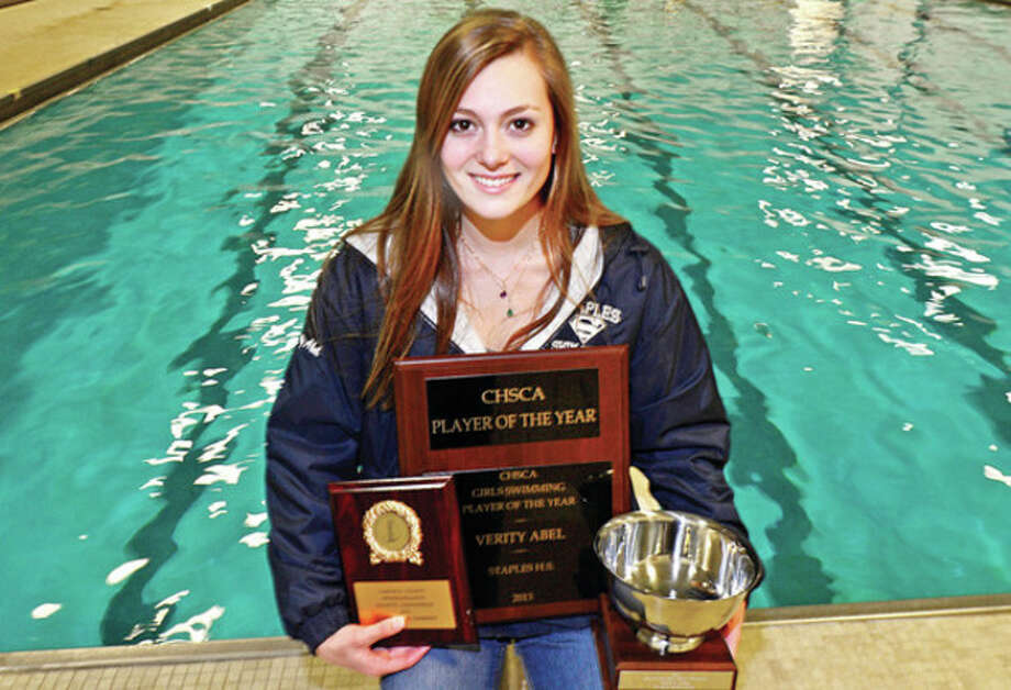 Hour photo/Erik TrautmannVerity Abel, The Hour's 2013 All-Area MVP in girls swimming, displays some of the hardware she won this past season, including the state Swimmer of the Year award, center. At left is the Most Outstanding Swimmer award she earned at the FCIAC Championships, while at right is M.O.S. award she received at the Class LL state meet. This is her second straight All-Area MVP award. / (C)2013, The Hour Newspapers, all rights reserved