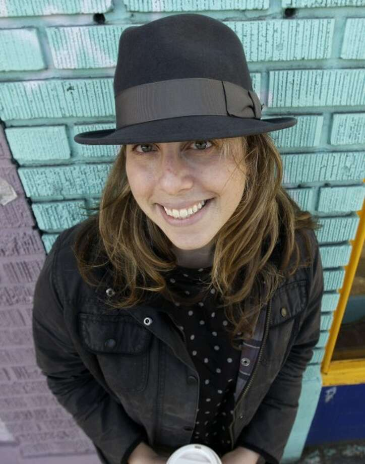 Associated Press business reporter Jessica Mintz wears a fedora in Seattle, Wednesday, Nov. 26, 2008. (AP Photo/Elaine Thompson)