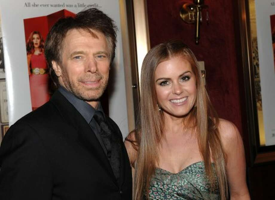 Producer Jerry Bruckheimer, left, and actress Isla Fisher attend the world premiere of ''Confessions Of A Shopaholic'' at the Ziegfeld Theater on Thursday, Feb. 5 in New York. (AP Photo/Evan Agostini)