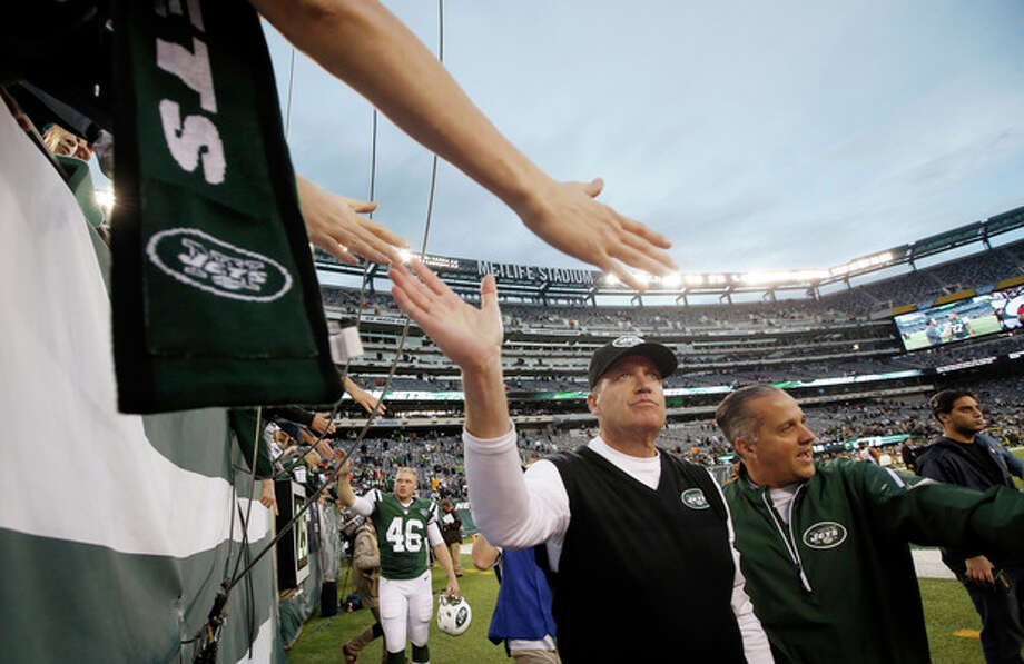 New York Jets head coach Rex Ryan, center, greets fans after an NFL football game against the Cleveland Browns, Sunday, Dec. 22, 2013, in East Rutherford, N.J. The Jets won the game 24-13. (AP Photo/Kathy Willens) / AP