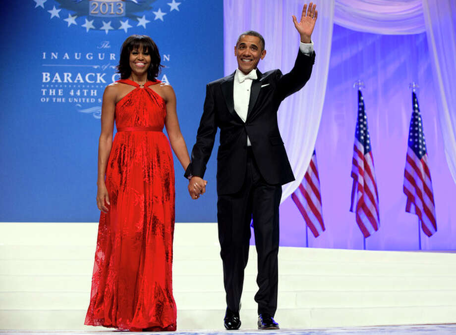 FILE - This Jan. 21, 2013 file photo shows President Barack Obama and first lady Michelle Obama at an Inaugural Ball at the Washington Convention Center in Washington, during the 57th Presidential Inauguration. Nobody would call bangs a new trend, but when the first lady's involved, things take on more significance. In fact, President Barack Obama did call his wife Michelle's new hairdo the most significant event of his second inauguration. (AP Photo/Carolyn Kaster, File) / AP