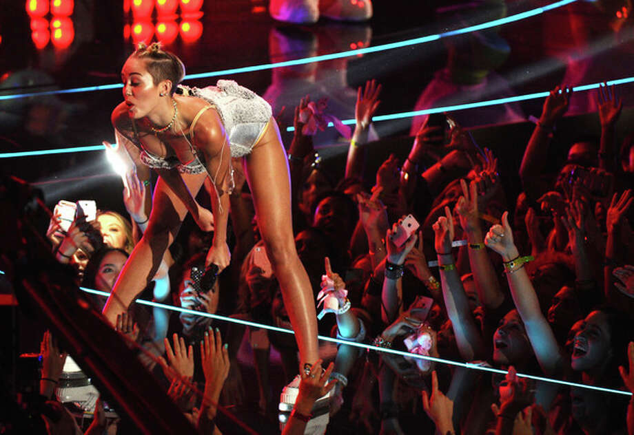 FILE - In this Aug. 25, 2013 file photo, Miley Cyrus performs at the MTV Video Music Awards at the Barclays Center in New York. From her twerk-a-thon at awards shows to her nearly nude poses to that now infamous tongue, we saw too many different sides (not to mention the backside) of the former teen queen. (Photo by Charles Sykes/Invision/AP, File) / Invision