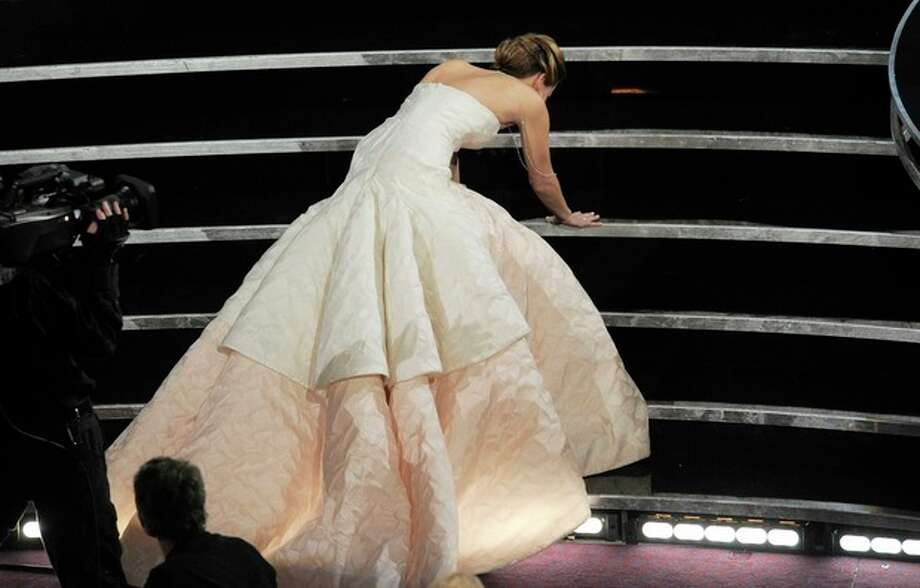"FILE - This Feb. 24, 2013 photo shows Jennifer Lawrence stumbling as she walks to the stage to accept the award for best actress in a leading role for ""Silver Linings Playbook"" during the Oscars at the Dolby Theatre in Los Angeles. (Photo by Chris Pizzello/Invision/AP, File) / Invision"