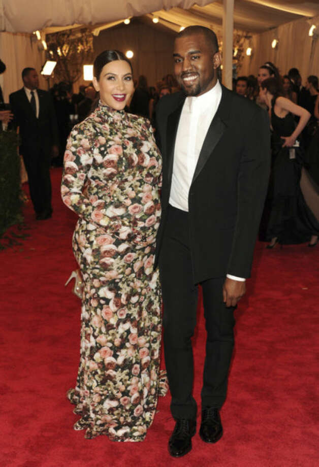 "FILE - In this May 6, 2013 file photo, Kim Kardashian and Kanye West attend The Metropolitan Museum of Art's Costume Institute benefit celebrating ""PUNK: Chaos to Couture"" in New York. Kardashian ranks number three on Google's list of most-searched people in the U.S., the only non-singer on the list. (Photo by Evan Agostini/Invision/AP, file)"