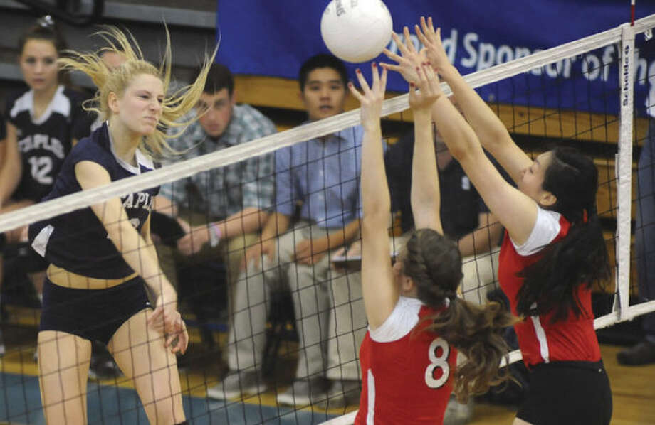 Hour photo/John NashAmerlia Brackett of Staples, left, follows through after blasting a kill attempt against Greenwich during the FCIAC finals. The Wreckers' senior outside hitter has been chosen as the MVP of The Hour's All-Area girls volleyball team.