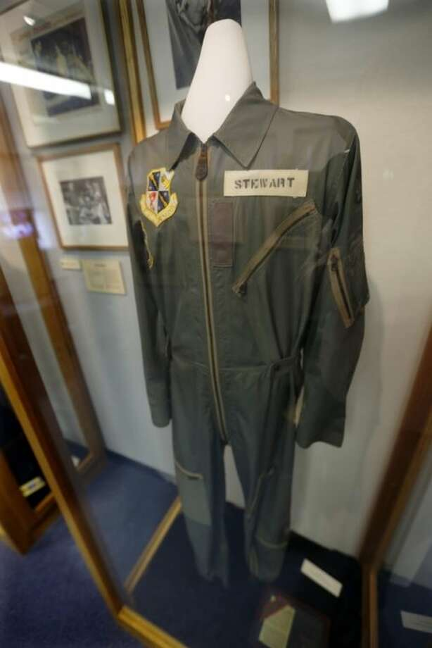 """In this photo made on Friday, Dec. 20, 2013, a flight suit that Hollywood legend Jimmy Stewart wore as a member of the Air Force Reserve is on display at the Jimmy Stewart Museum in indiana, Pa. The museum dedicated to the life of the star of many films including the holiday favorite """"It's A Wonderful Life"""" is located in the off-the-beaten track town where Stewart grew up. The museum still attracts visitors from all over the country. It's full of displays not just about Hollywood, but about Stewart's service as a bomber pilot in World War II, his well-to-do ancestors, and his family life. (AP Photo/Keith Srakocic)"""