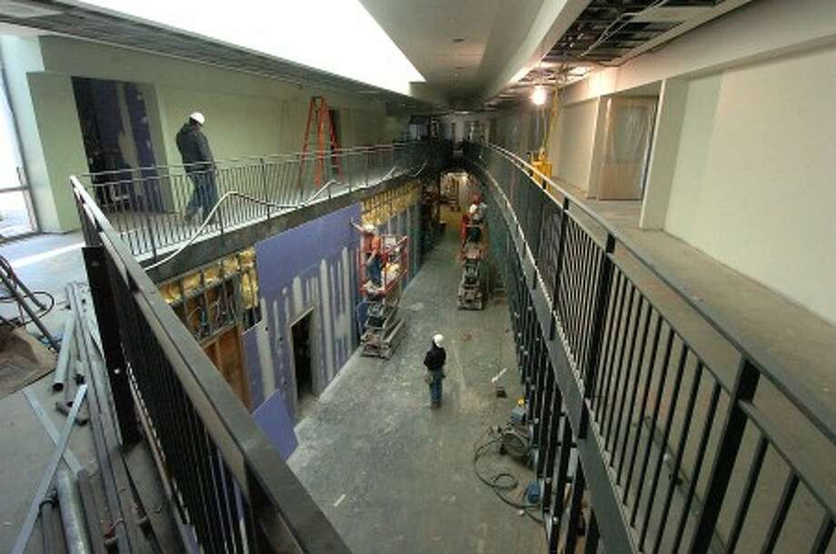 Photo/Alex von Kleydorff. Work progresses in an atrium walkway at Rogers Magnet School Stamford.