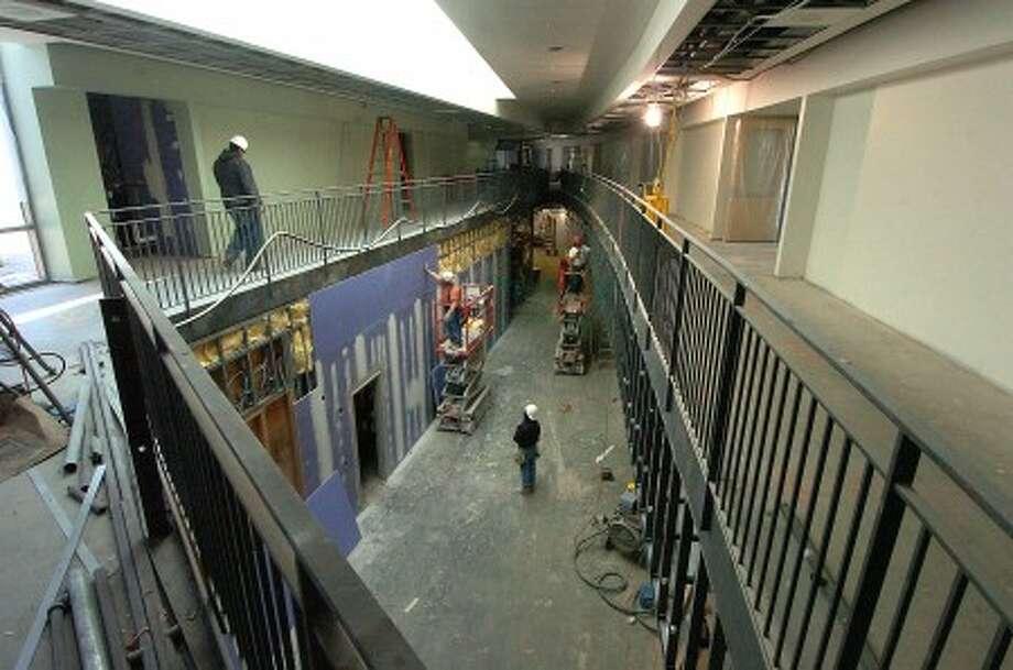 Photo/Alex von Kleydorff. Work progresses in an atrium walkway at Rogers Magnet School Stamford.