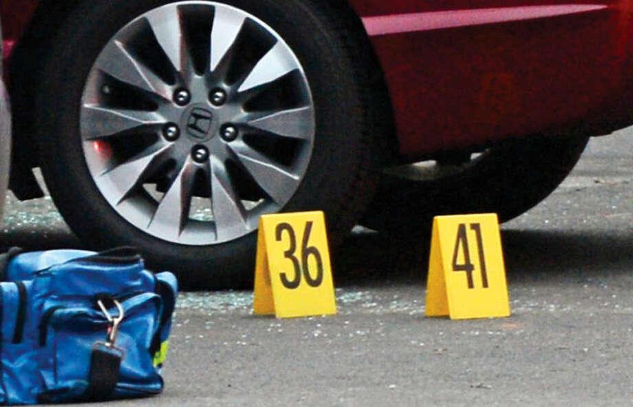 Hour photo / Erik Trautmann Norwalk police investigate a shooting at Monterey Village Tuesday evening.